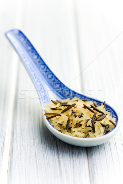 wild rice in ceramic spoon Stock photo © jirkaejc