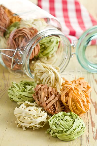 Kleurrijk pasta tagliatelle keukentafel achtergrond keuken Stockfoto © jirkaejc