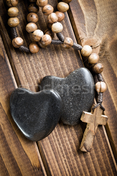 stone hearts with rosary beads  Stock photo © jirkaejc