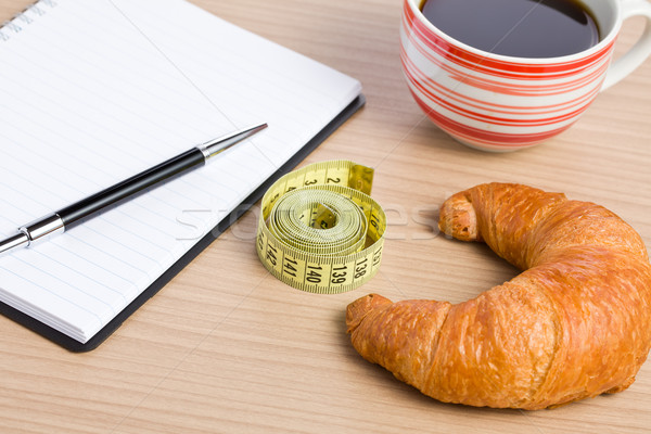diet concept . croissant and measuring tape Stock photo © jirkaejc