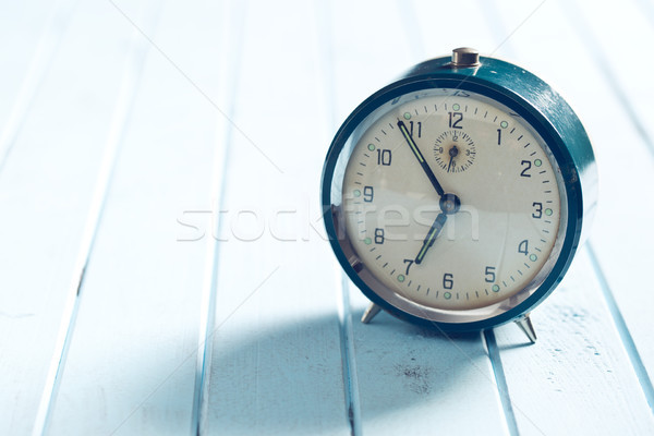 analog alarm clock on wooden table Stock photo © jirkaejc
