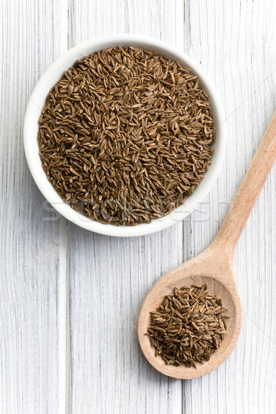 cumin seeds in wooden spoon Stock photo © jirkaejc