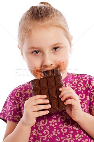 Fiatal lány eszik csokoládé szelet stúdiófelvétel arc gyermek Stock fotó © jirkaejc