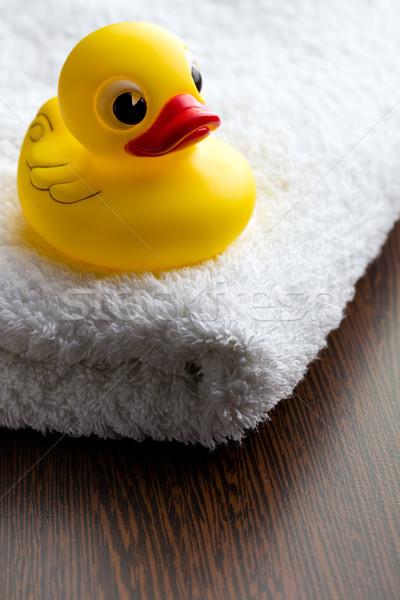 yellow bath duck on white towel Stock photo © jirkaejc