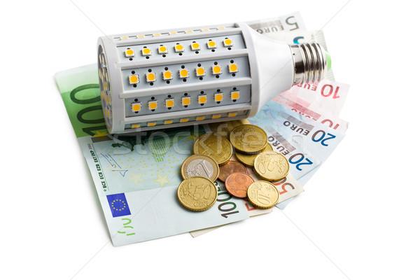 LED lightbulb with euro money Stock photo © jirkaejc