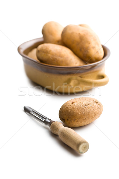 wooden peeler and potatoes Stock photo © jirkaejc