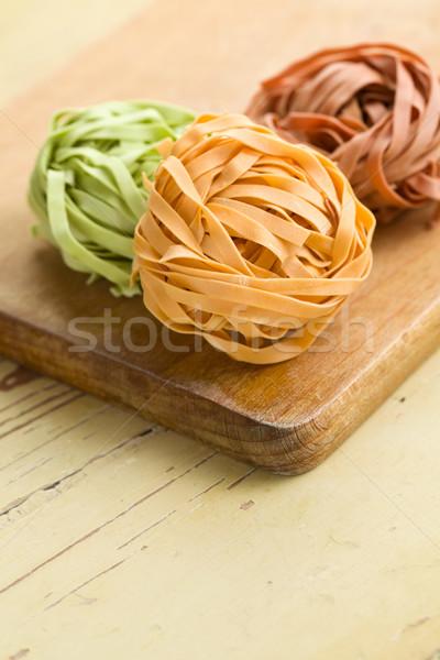 Kleurrijk pasta tagliatelle houten tafel achtergrond keuken Stockfoto © jirkaejc