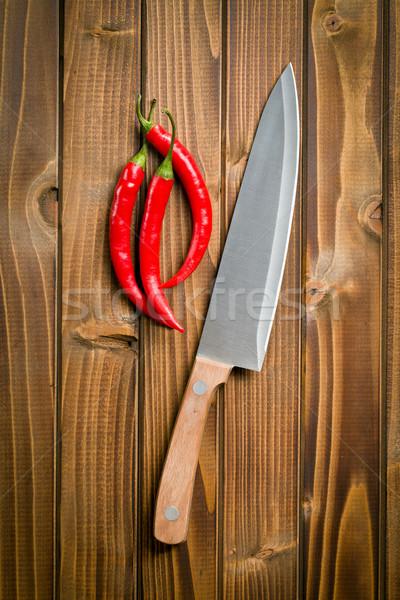 chili peppers with sharp knife Stock photo © jirkaejc
