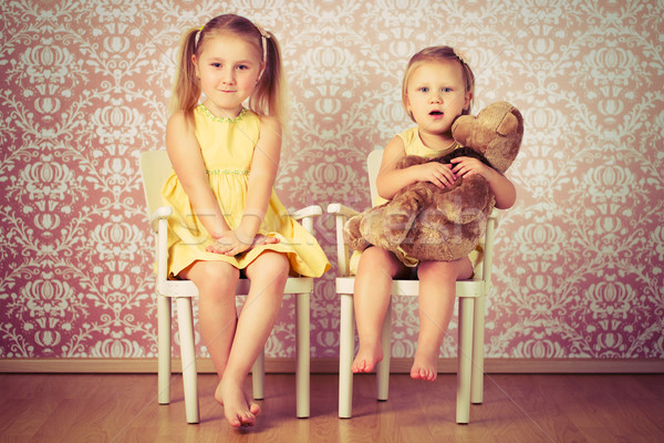 two sisters sitting on a chair Stock photo © jirkaejc
