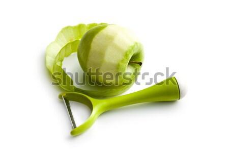 peeled green apple with peeler Stock photo © jirkaejc