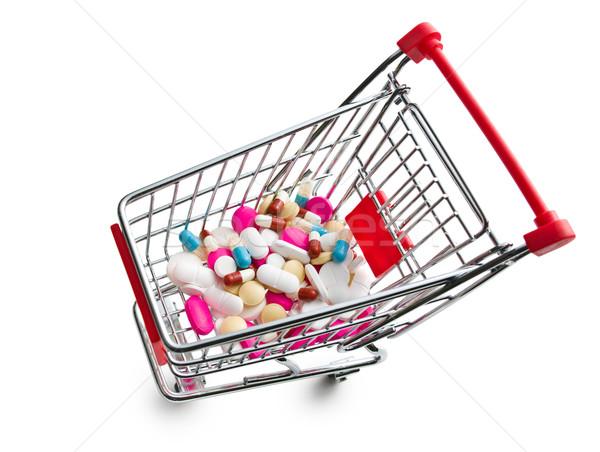 Foto stock: Pílulas · carrinho · de · compras · colorido · branco · médico · fundo