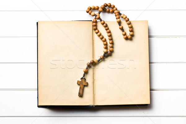 Wooden rosary beads with old book Stock photo © jirkaejc