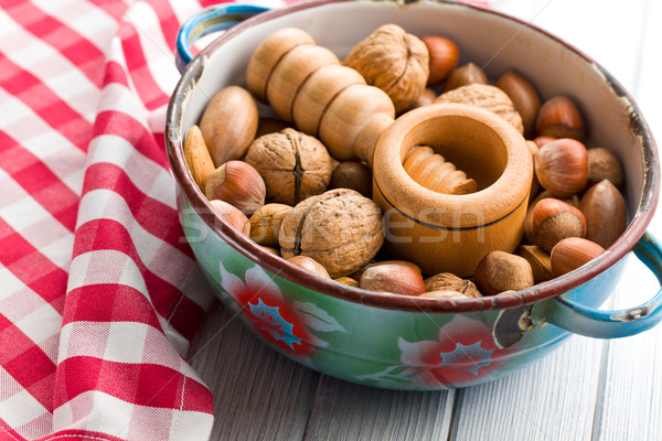 wooden nutcracker and nuts  Stock photo © jirkaejc