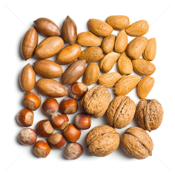 Stock photo: various unpeeled nuts