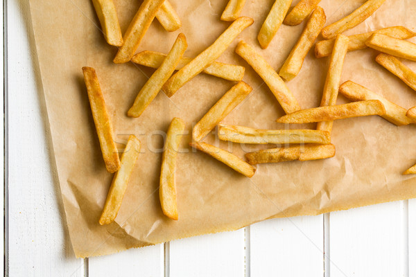 french fries on baking paper Stock photo © jirkaejc