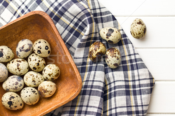Quail eggs in wooden bowl Stock photo © jirkaejc