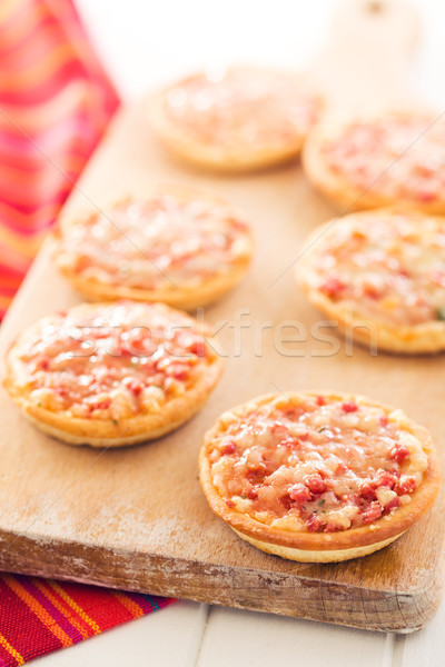 Stock photo: mini pizza on cutting board