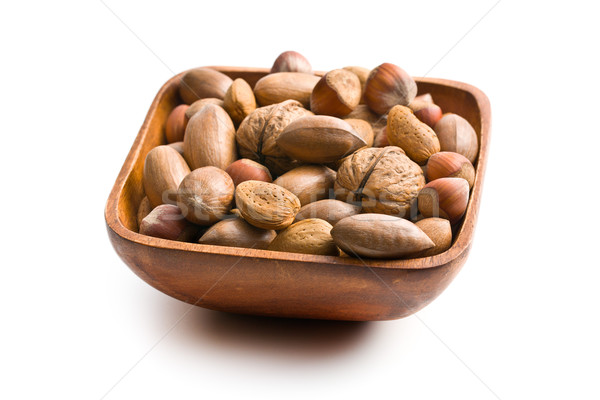 various unpeeled nuts in wooden bowl Stock photo © jirkaejc