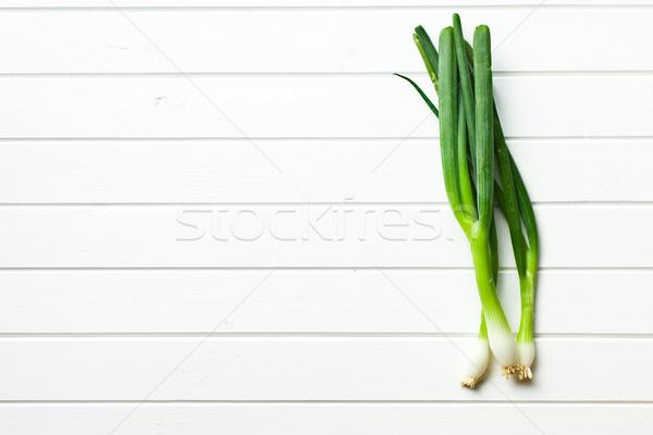 spring onion on white table Stock photo © jirkaejc