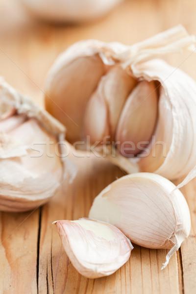fresh garlic on kitchen table Stock photo © jirkaejc
