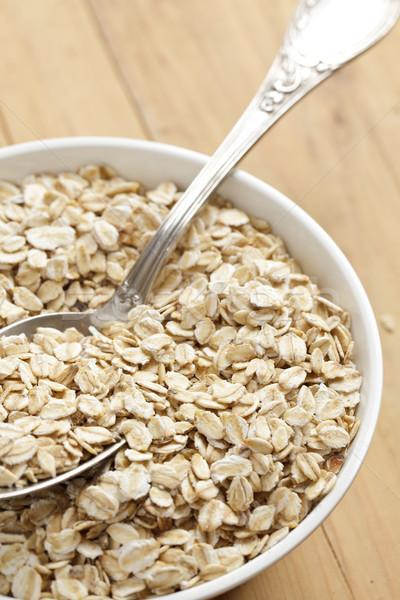 oatmeal on wooden table Stock photo © jirkaejc