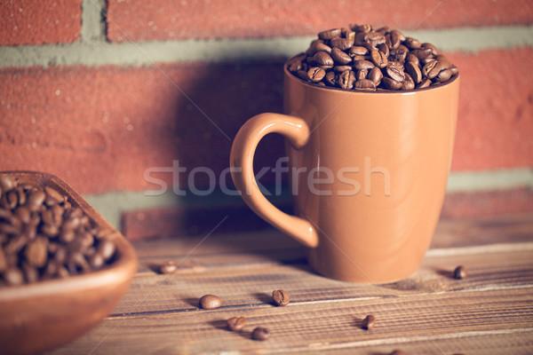 Chicchi di caffè mug muro di mattoni alimentare caffè muro Foto d'archivio © jirkaejc
