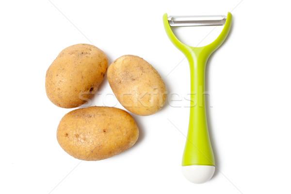 fresh potatoes with vegetable peeler Stock photo © jirkaejc