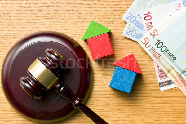 wooden houses with money and judge gavel Stock photo © jirkaejc