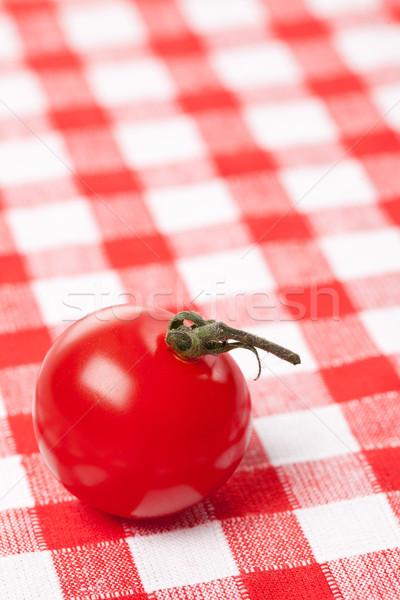 cherry tomato on checkered tablecloth Stock photo © jirkaejc