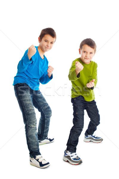 Two boys in a fighting stance. Stock photo © jirkaejc
