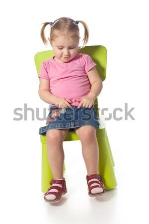 Piccolo bambino sedia sorriso bellezza verde Foto d'archivio © jirkaejc