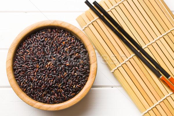 black rice in wooden bowl Stock photo © jirkaejc
