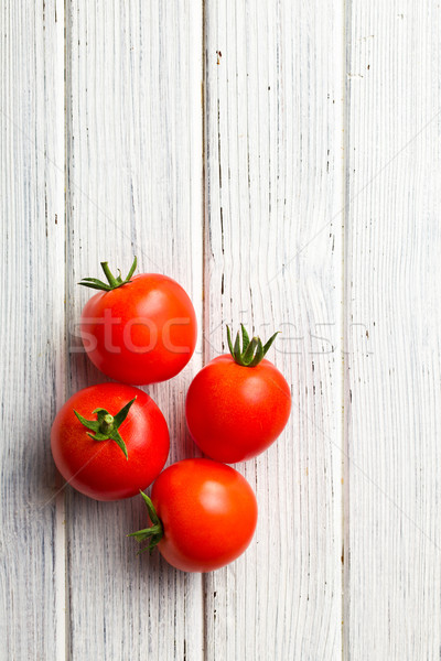 red tomatoes on wooden table Stock photo © jirkaejc