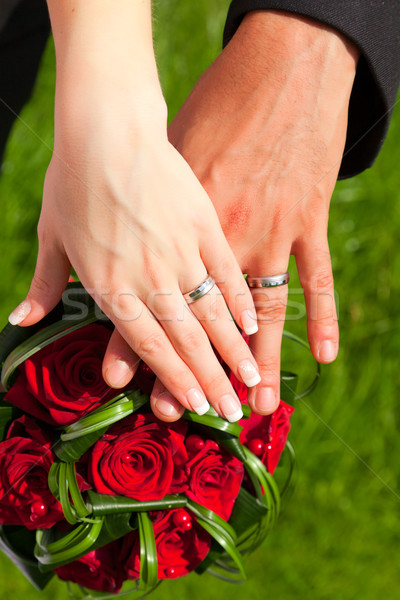 hands with rings on wedding bouquet Stock photo © jirkaejc