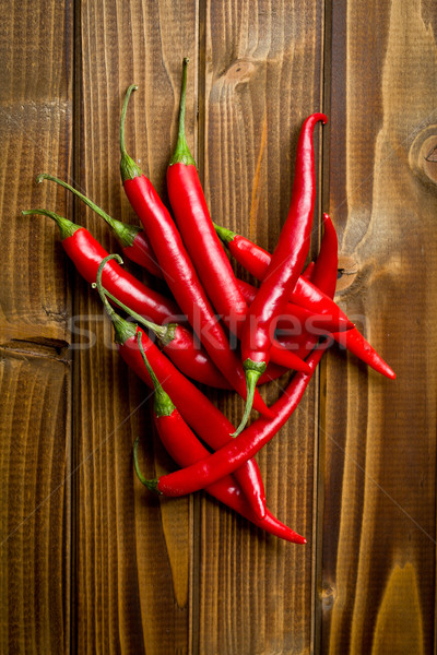 chili peppers on wooden background Stock photo © jirkaejc