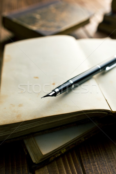 open book with fountain pen Stock photo © jirkaejc