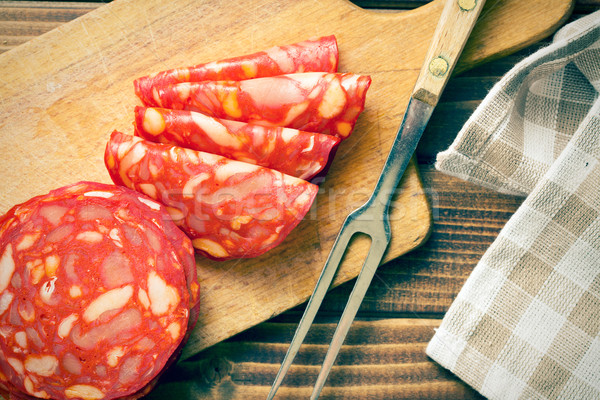 sliced chorizo salami with fork Stock photo © jirkaejc