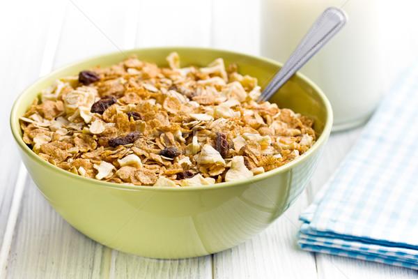 Knapperig müsli kom melk keukentafel ontbijt Stockfoto © jirkaejc
