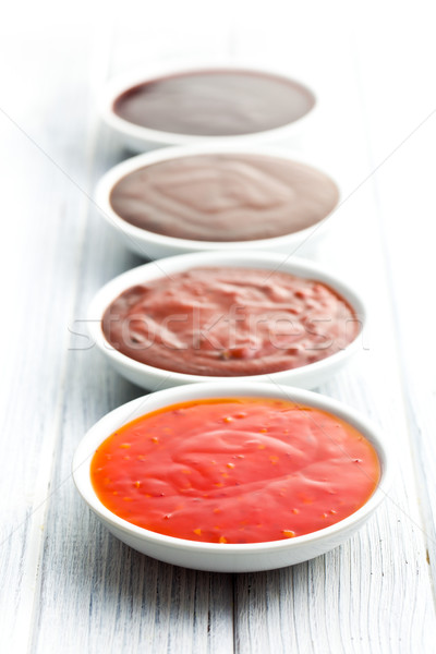 Stock photo: various barbecue sauces in ceramic bowls