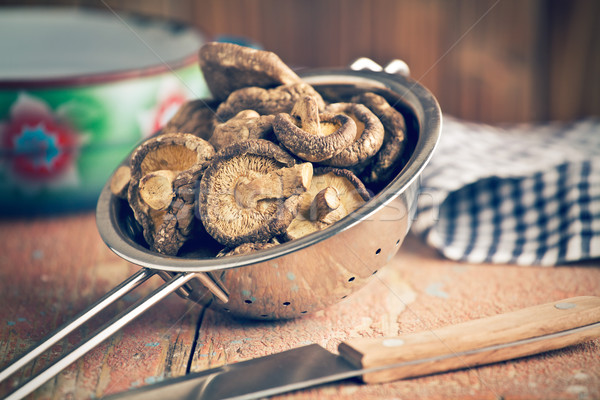 Stock photo: dried shiitake mushrooms in colander