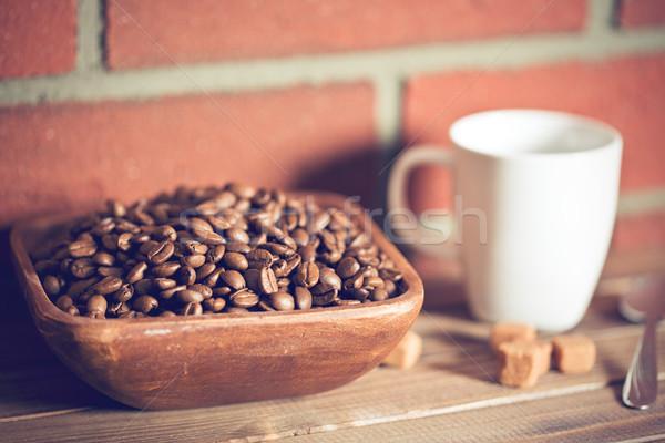 Granos de café tazón pared de ladrillo alimentos café pared Foto stock © jirkaejc