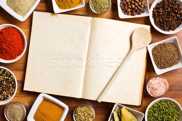 Cookbook and various spices and herbs. Stock photo © jirkaejc