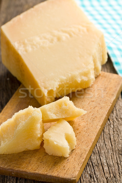 pieces of Italian hard cheese on a wooden table Stock photo © jirkaejc