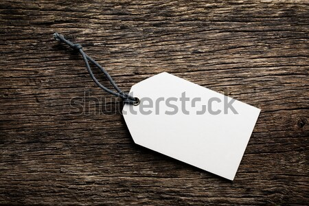 Stock photo: blank price tag label on wooden background
