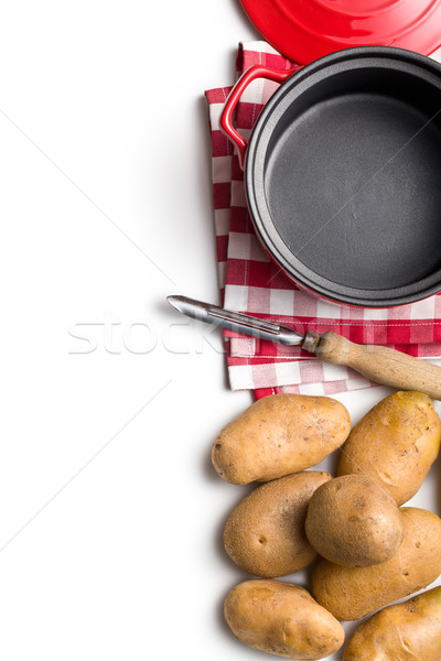 uncooked potatoes and old wooden peeler Stock photo © jirkaejc
