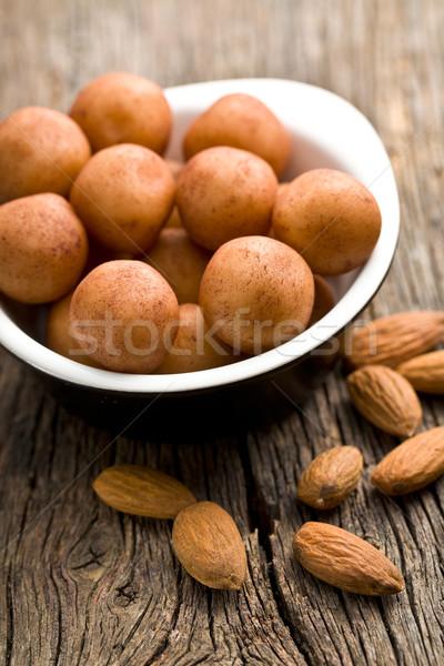 Marcipán golyók mandulák öreg fa asztal csoport Stock fotó © jirkaejc