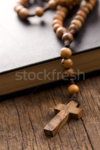 Wooden rosary beads and holy bible Stock photo © jirkaejc