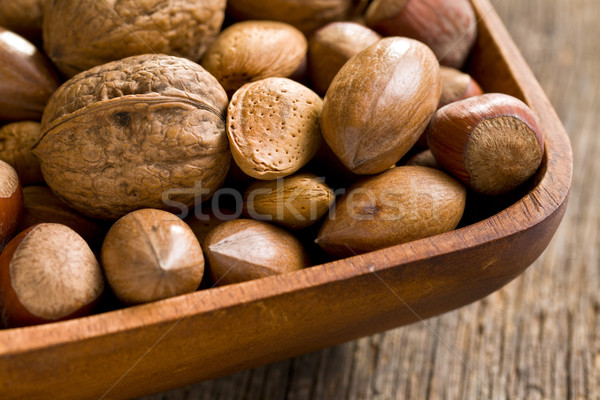 Stock photo: various unpeeled nuts in wooden bowl