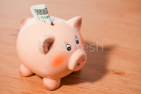 piggy bank with american currency Stock photo © jirkaejc
