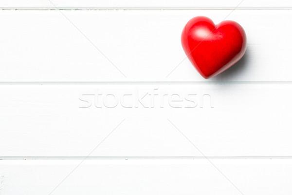 red stone heart on white wooden background Stock photo © jirkaejc